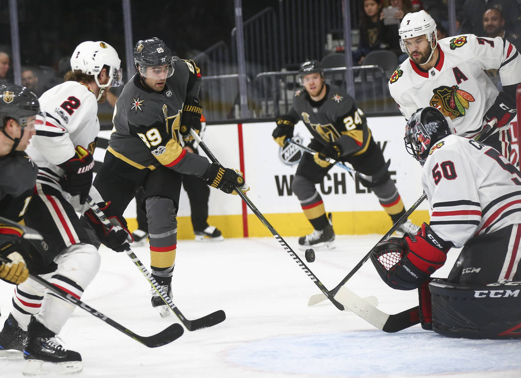 Golden Knights' Alex Tuch (89) tries to get the puck in against Chicago Blackhawks' goalie Corey Crawford (50) during an NHL hockey game at T-Mobile Arena in Las Vegas on Tuesday, Oct. 24, 2017. C ...