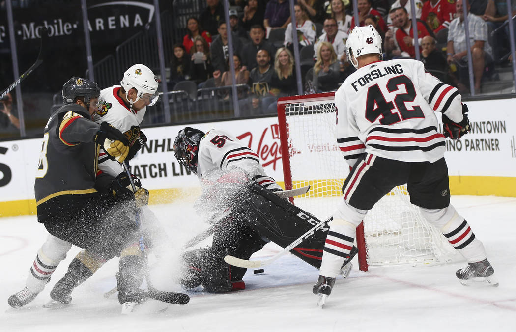 Chicago Blackhawks' goalie Corey Crawford (50) defends the goal seconds before being scored on by Golden Knights' Tomas Nosek (92), not pictured, during an NHL hockey game at T-Mobile Arena in Las ...