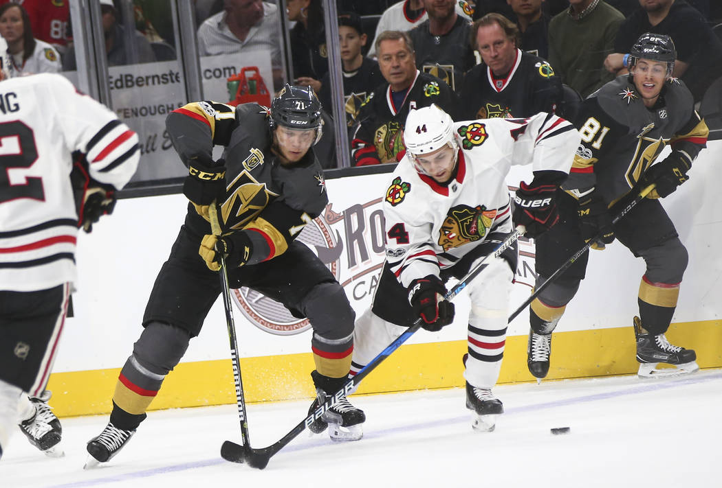 Golden Knights' center William Karlsson (71) and Chicago Blackhawks' defenseman Jan Rutta (44) battle for the puck during an NHL hockey game at T-Mobile Arena in Las Vegas on Tuesday, Oct. 24, 201 ...