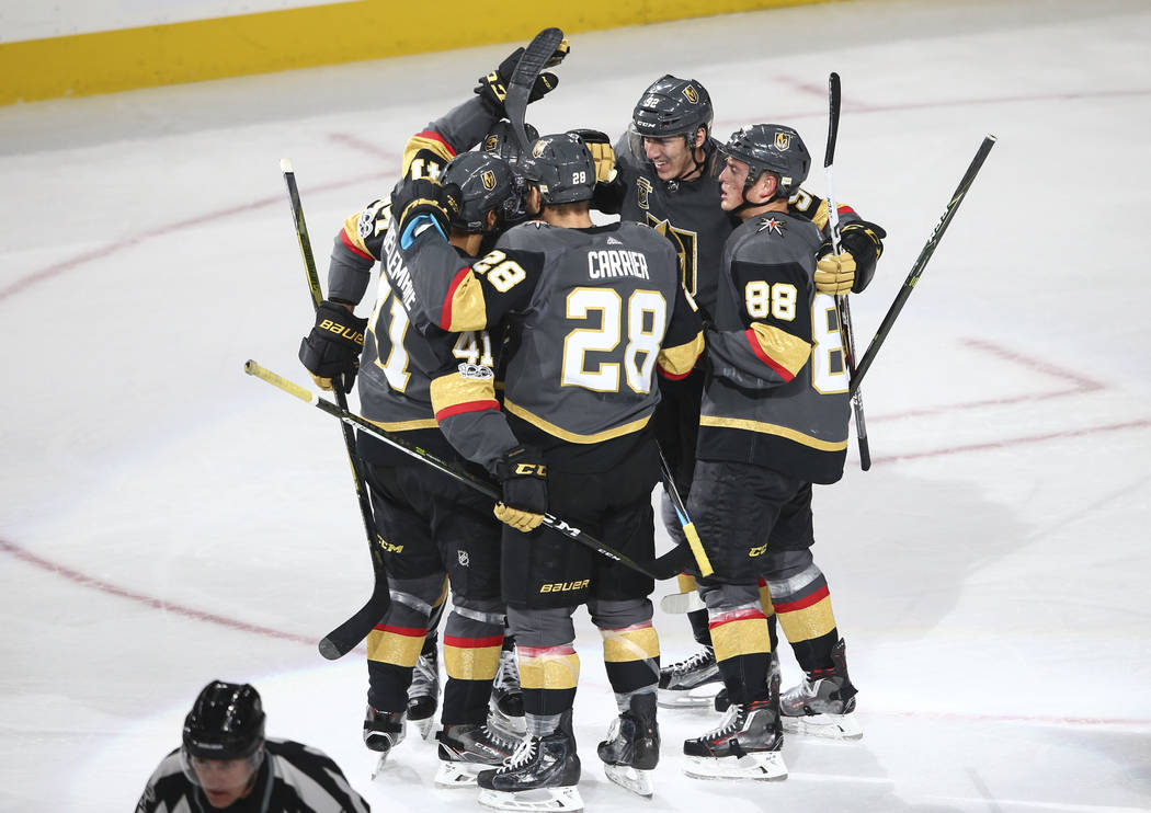 Golden Knights players celebrate a goal by Pierre-Edouard Bellemare (41) against the Chicago Blackhawks during an NHL hockey game at T-Mobile Arena in Las Vegas on Tuesday, Oct. 24, 2017. Chase St ...