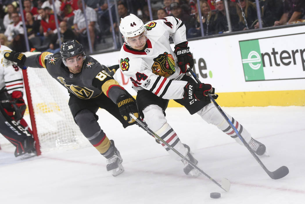 Golden Knights' Alex Tuch (89) battles for the puck  against Chicago Blackhawks' Jan Rutta (44) during an NHL hockey game at T-Mobile Arena in Las Vegas on Tuesday, Oct. 24, 2017. Chase Stevens La ...