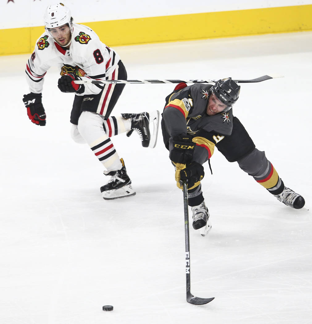 Golden Knights' Brayden McNabb (3) guides the puck against Chicago Blackhawks' Nick Schmaltz (8) during an NHL hockey game at T-Mobile Arena in Las Vegas on Tuesday, Oct. 24, 2017. Chase Stevens L ...