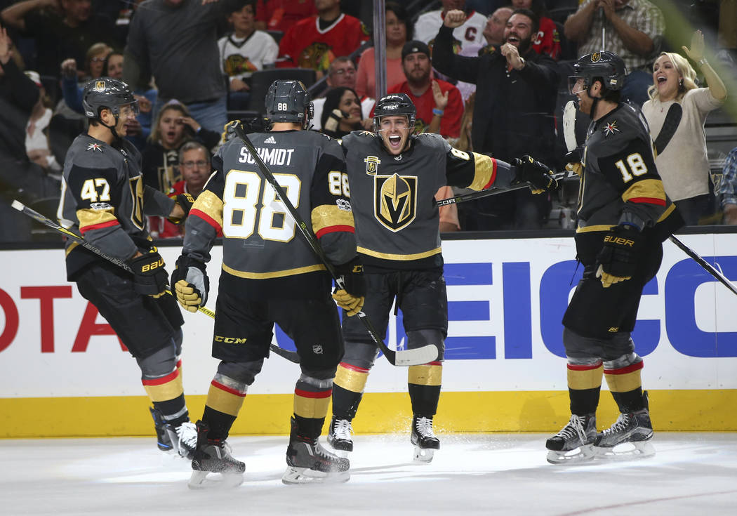 Golden Knights' Jonathan Marchessault, third from left, celebrates his goal against the Chicago Blackhawks with teammates during an NHL hockey game at T-Mobile Arena in Las Vegas on Tuesday, Oct.  ...