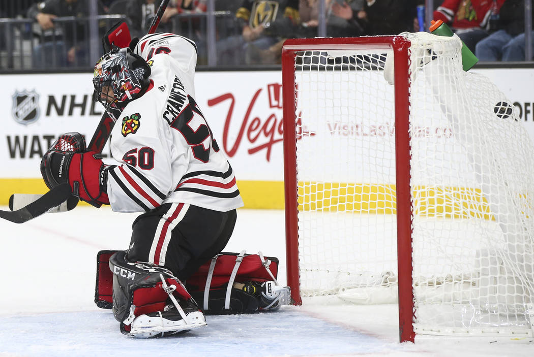 Chicago Blackhawks' goalie Corey Crawford (50) fails to block a shot from Golden Knights' Jonathan Marchessault, not pictured, as the puck flies into the net during an NHL hockey game at T-Mobile  ...