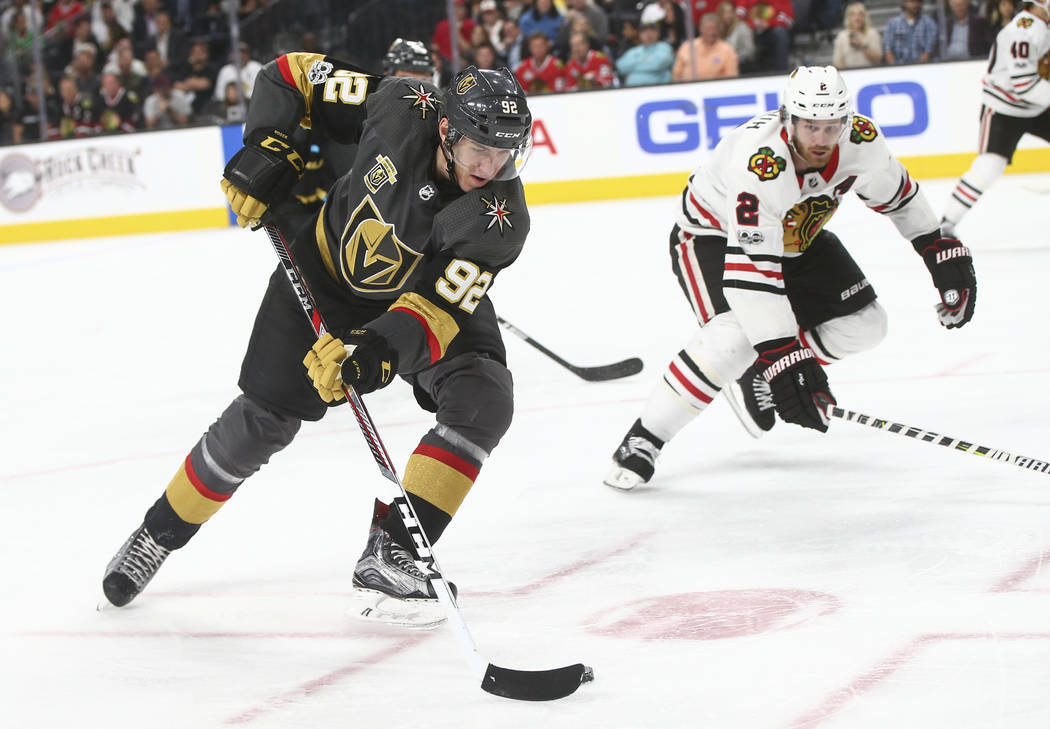 Golden Knights' Tomas Nosek (92) moves the puck against Chicago Blackhawks' Duncan Keith (2) during an NHL hockey game at T-Mobile Arena in Las Vegas on Tuesday, Oct. 24, 2017. Chase Stevens Las V ...