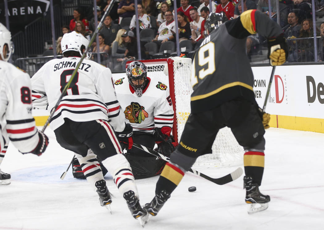 Chicago Blackhawks' goalie Corey Crawford (50) looks to block a shot from Golden Knights' Reilly Smith (19) during an NHL hockey game at T-Mobile Arena in Las Vegas on Tuesday, Oct. 24, 2017. Chas ...
