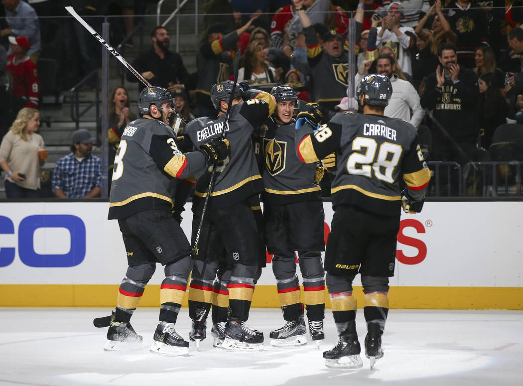 Golden Knights players celebrate a goal by Tomas Nosek, second from right, against the Chicago Blackhawks during an NHL hockey game at T-Mobile Arena in Las Vegas on Tuesday, Oct. 24, 2017. Chase  ...