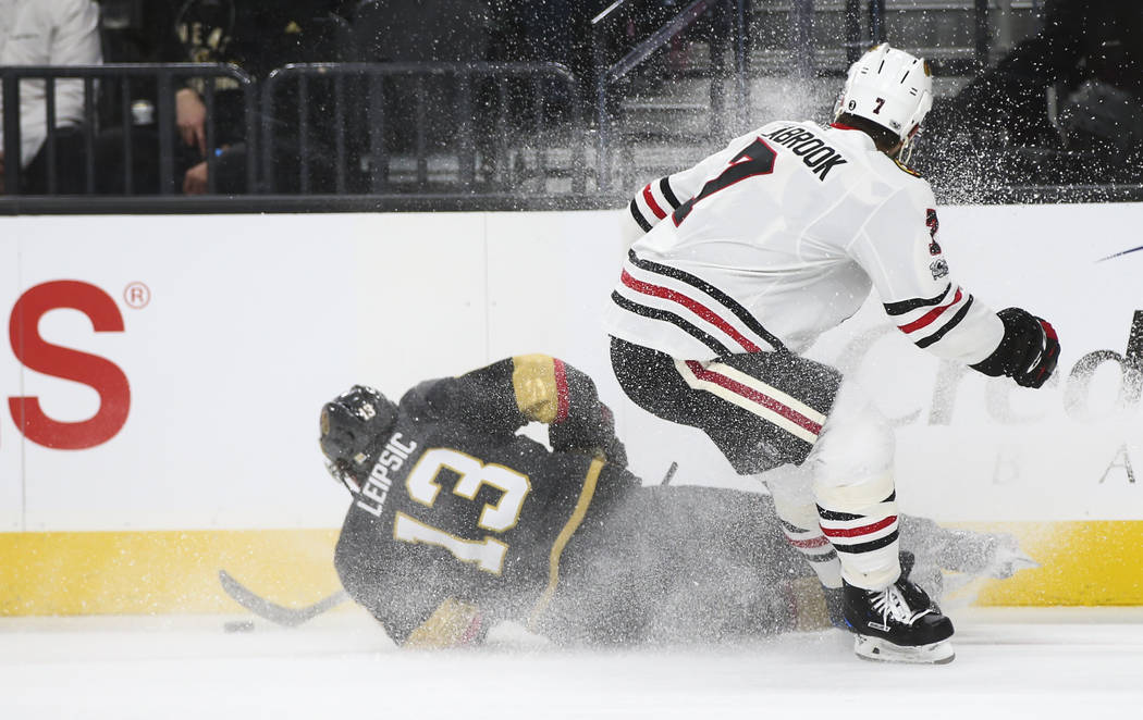 Golden Knights' Brendan Leipsic (13) gets tripped up by Chicago Blackhawks' Brent Seabrook (7) during an NHL hockey game at T-Mobile Arena in Las Vegas on Tuesday, Oct. 24, 2017. Chase Stevens Las ...