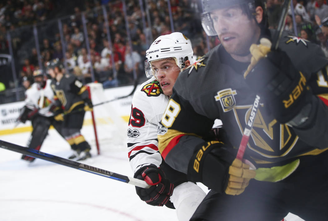 Golden Knights' James Neal (18) and Chicago Blackhawks' Jonathan Toews (19) during an NHL hockey game at T-Mobile Arena in Las Vegas on Tuesday, Oct. 24, 2017. Chase Stevens Las Vegas Review-Journ ...
