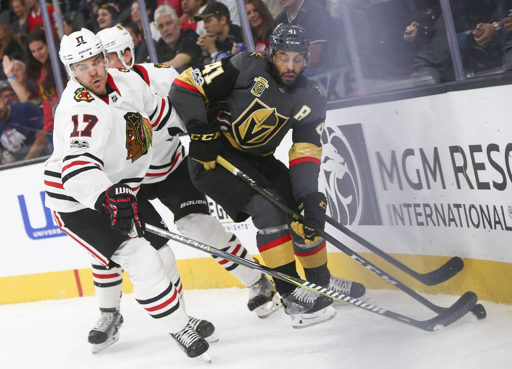 Golden Knights' Pierre-Edouard Bellemare (41) battles for the puck against Chicago Blackhawks' Lance Bouma (17) during an NHL hockey game at T-Mobile Arena in Las Vegas on Tuesday, Oct. 24, 2017.  ...