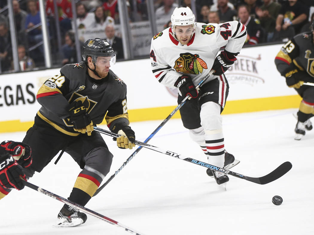 Golden Knights' Oscar Lindberg (24) guides the puck as Chicago Blackhawks' Jan Rutta (44) defends during an NHL hockey game at T-Mobile Arena in Las Vegas on Tuesday, Oct. 24, 2017. Chase Stevens  ...