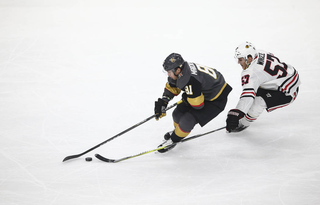 Golden Knights' Jonathan Marchessault (81) guides the puck as Chicago Blackhawks' Tommy Wingels (57) defends during an NHL hockey game at T-Mobile Arena in Las Vegas on Tuesday, Oct. 24, 2017. Cha ...