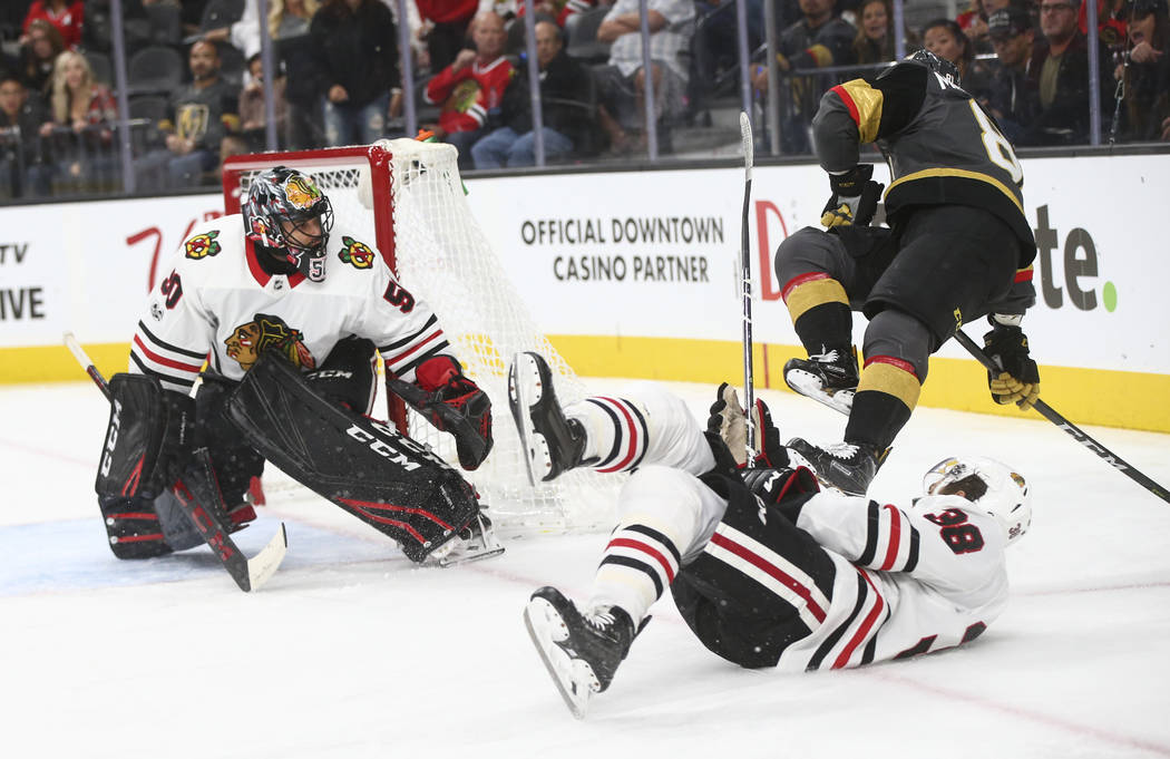 Golden Knights' Jonathan Marchessault (81) gets tripped up over Chicago Blackhawks' Ryan Hartman (38) during an NHL hockey game at T-Mobile Arena in Las Vegas on Tuesday, Oct. 24, 2017. Chase Stev ...
