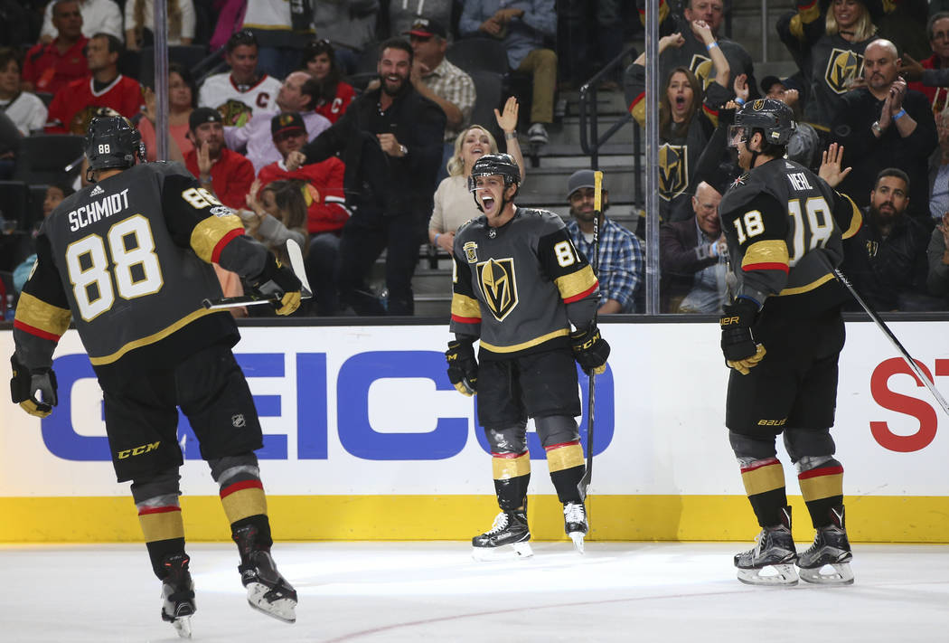 Golden Knights' Jonathan Marchessault, center, celebrates his goal against the Chicago Blackhawks with teammates during an NHL hockey game at T-Mobile Arena in Las Vegas on Tuesday, Oct. 24, 2017. ...