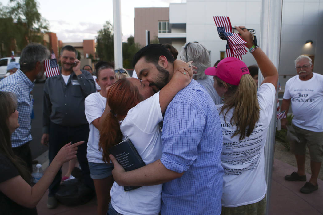 Andrea Parker kisses her husband Eric Parker after he and three other defendants in the Bunkerville standoff case were released at the Henderson Detention Center on Tuesday, Aug. 22, 2017. Chase S ...