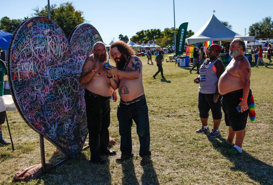 People gather at a heart honoring the victims of the Route 91 Harvest Festival during the Las Vegas PRIDE Festival at Sunset Park in Las Vegas, Sunday, Oct. 22, 2017. Joel Angel Juarez Las Vegas R ...