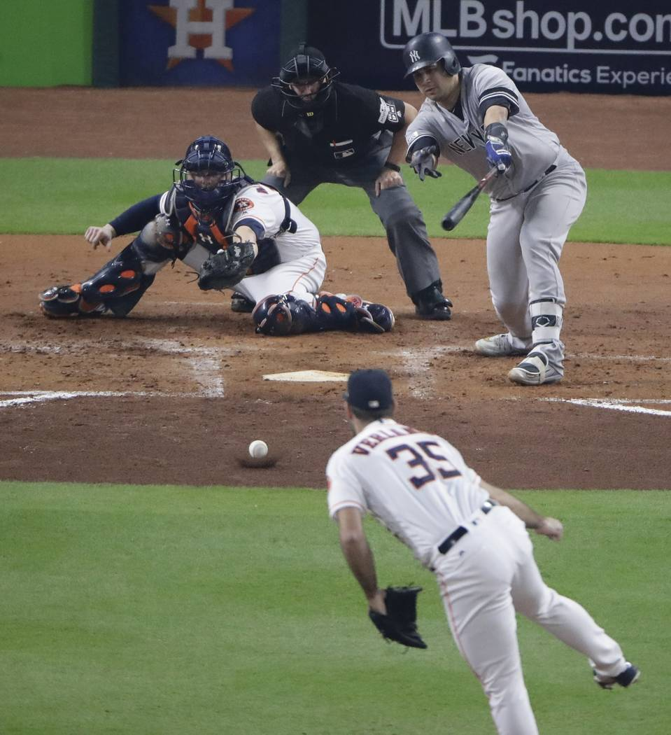 New York Yankees' Gary Sanchez hits a ground ball back to Houston Astros starting pitcher Justin Verlander during the fourth inning of Game 6 of baseball's American League Championship Series Frid ...
