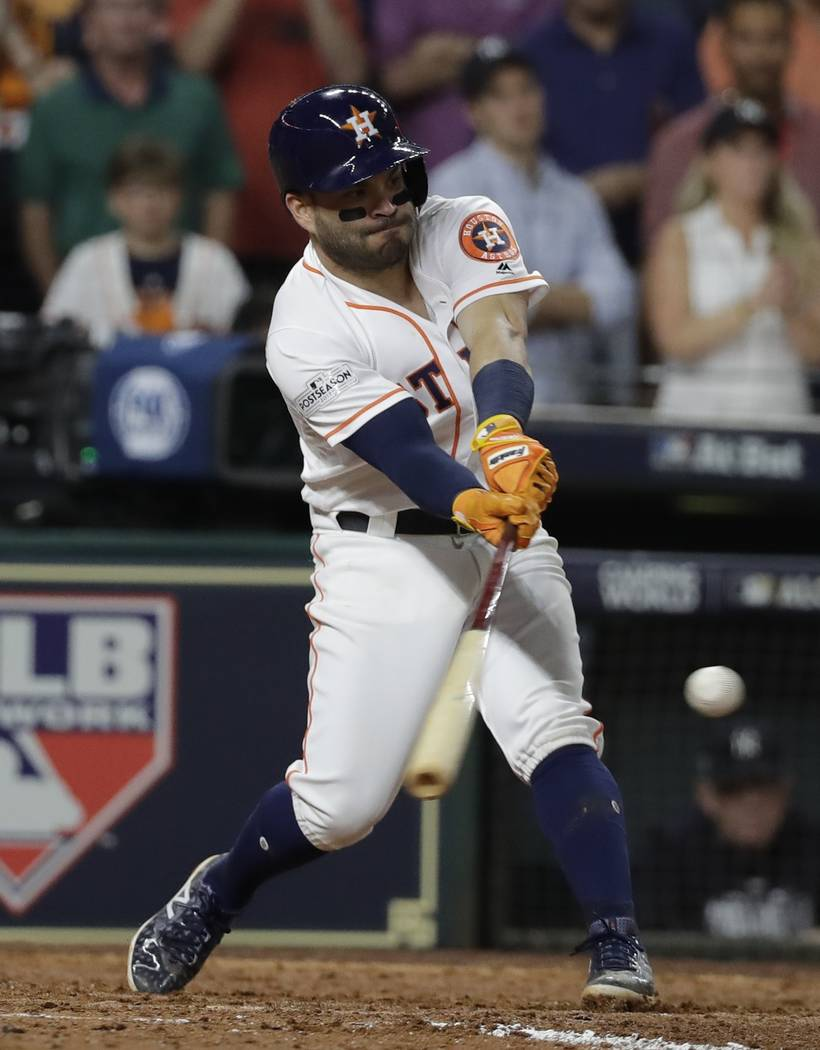 Houston Astros' Jose Altuve hits a home run during the eighth inning of Game 6 of baseball's American League Championship Series against the New York Yankees Friday, Oct. 20, 2017, in Houston. (AP ...