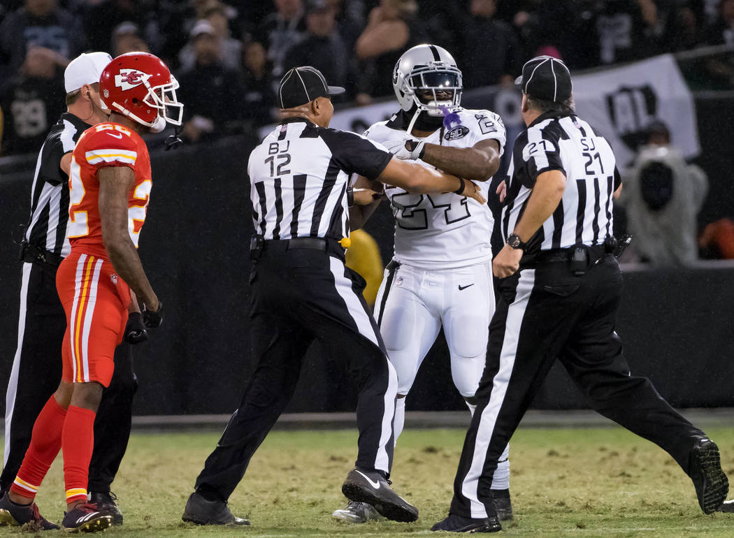 Oct 19, 2017; Oakland, CA, USA; Oakland Raiders running back Marshawn Lynch (24) in an altercation with the referees during the second quarter against the Kansas City Chiefs at Oakland Coliseum. M ...