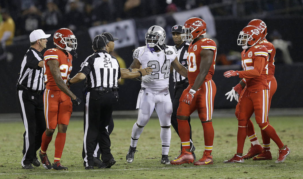 Oakland Raiders running back Marshawn Lynch (24) talks with officials before being ejected during the first half of an NFL football game between the Raiders and the Kansas City Chiefs in Oakland,  ...