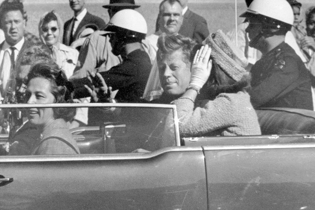 In this Nov. 22, 1963 file photo, President John F. Kennedy waves from his car in a motorcade in Dallas. Riding with Kennedy are First Lady Jacqueline Kennedy, right, Nellie Connally, second from  ...