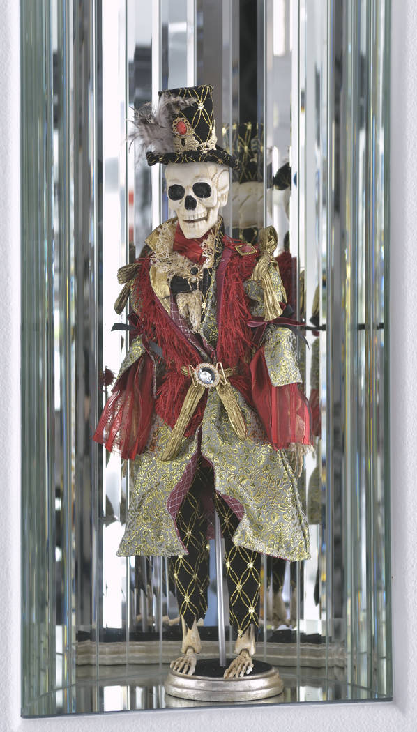 The entry displays many Halloween decorations. (Bill Hughes Real Estate Millions)