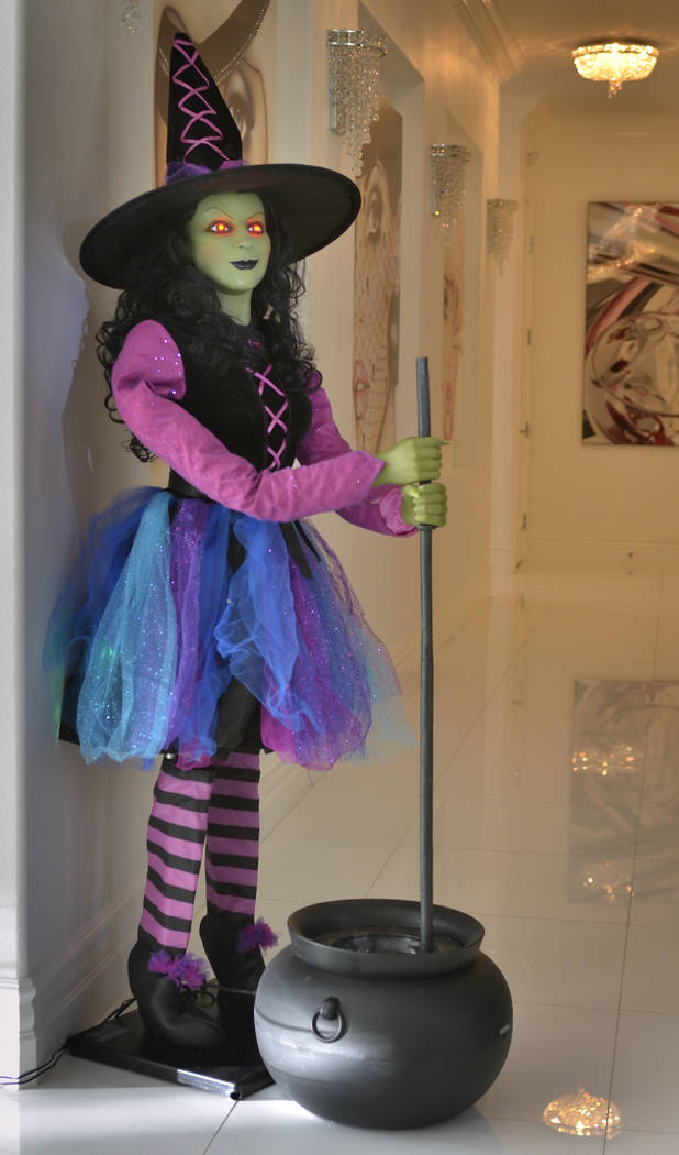 An electronic witch greets guests in a hallway. (Bill Hughes Real Estate Millions)