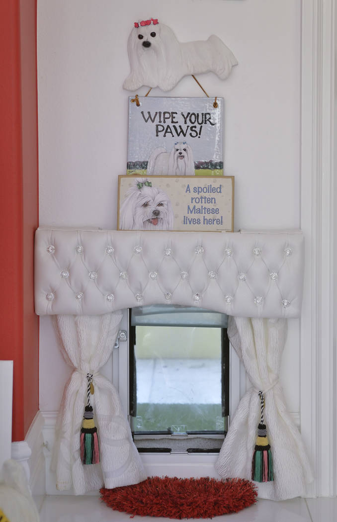 Even the doggie door has a rhinestone topper and tasseled curtains. (Bill Hughes Real Estate Millions)