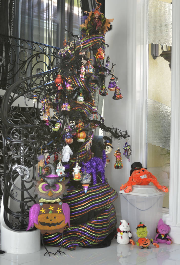 A Halloween tree greets visitors at the home's staircase. (Bill Hughes Real Estate Millions)