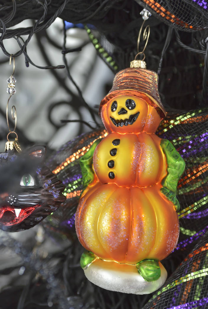 A Halloween tree holds lots of detailed decorations. (Bill Hughes Real Estate Millions)