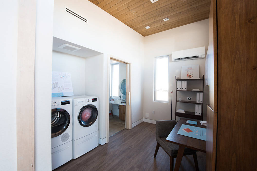 "The UNLV ""Sinatra Living"" home's utility room includes an office and laundry area. Utility room opens to bath and main living room as part of a circular floor plan design. (UNLV)"