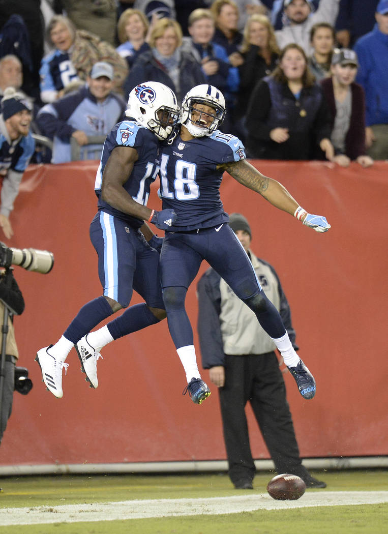 Tennessee Titans wide receiver Taywan Taylor (13) celebrates with Rishard Matthews (18) after Taylor scored a touchdown on a 53-yard pass against the Indianapolis Colts in the second half of an NF ...
