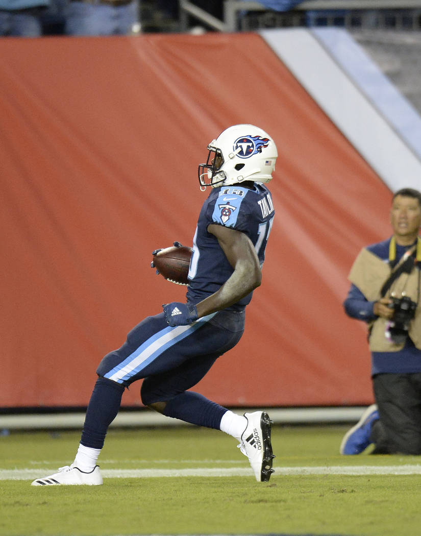 Tennessee Titans wide receiver Taywan Taylor (13) scores a touchdown on a 53-yard pass against the Indianapolis Colts in the second half of an NFL football game Monday, Oct. 16, 2017, in Nashville ...