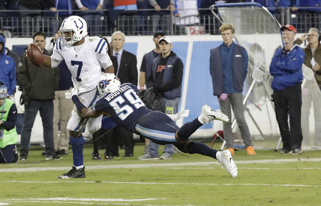 Tennessee Titans inside linebacker Wesley Woodyard (59) brings down Indianapolis Colts quarterback Jacoby Brissett (7) to stop a Colts' drive late in the fourth quarter in an NFL football game Mon ...