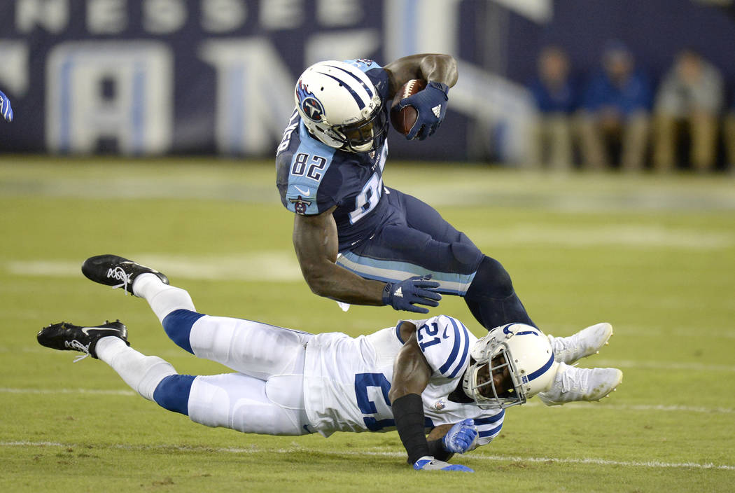 Tennessee Titans tight end Delanie Walker (82) is tripped up by Indianapolis Colts cornerback Vontae Davis (21) in the first half of an NFL football game Monday, Oct. 16, 2017, in Nashville, Tenn. ...
