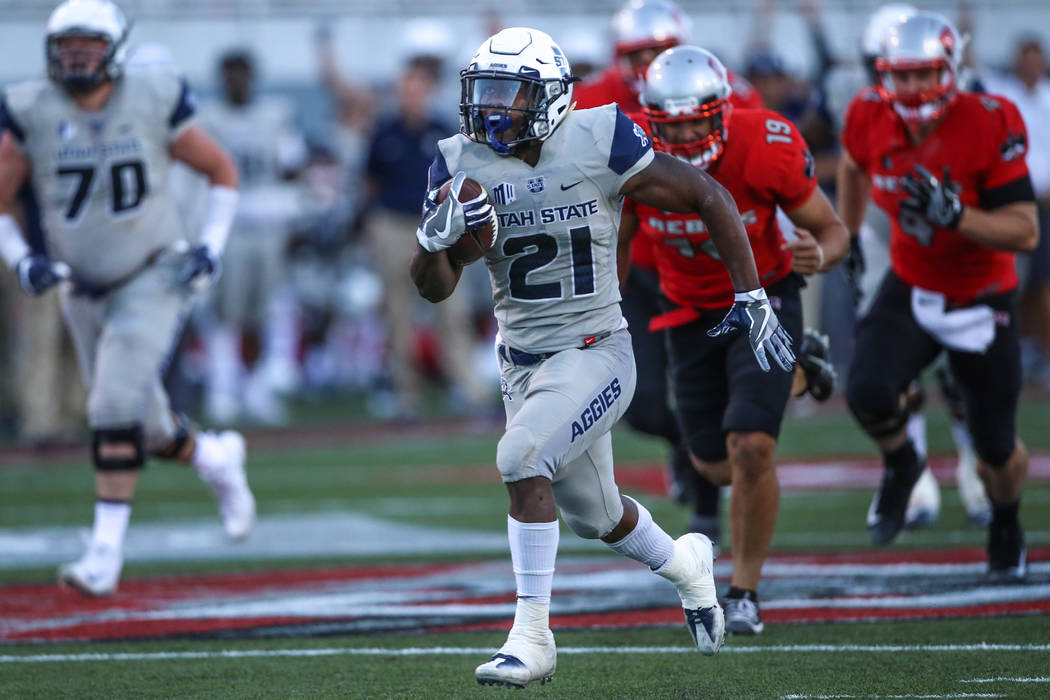 Utah State Aggies running back LaJuan Hunt (21) runs the ball for a touchdown against the UNLV Rebels during the fourth quarter of a football game at Sam Boyd Stadium in Las Vegas, Saturday, Oct.  ...