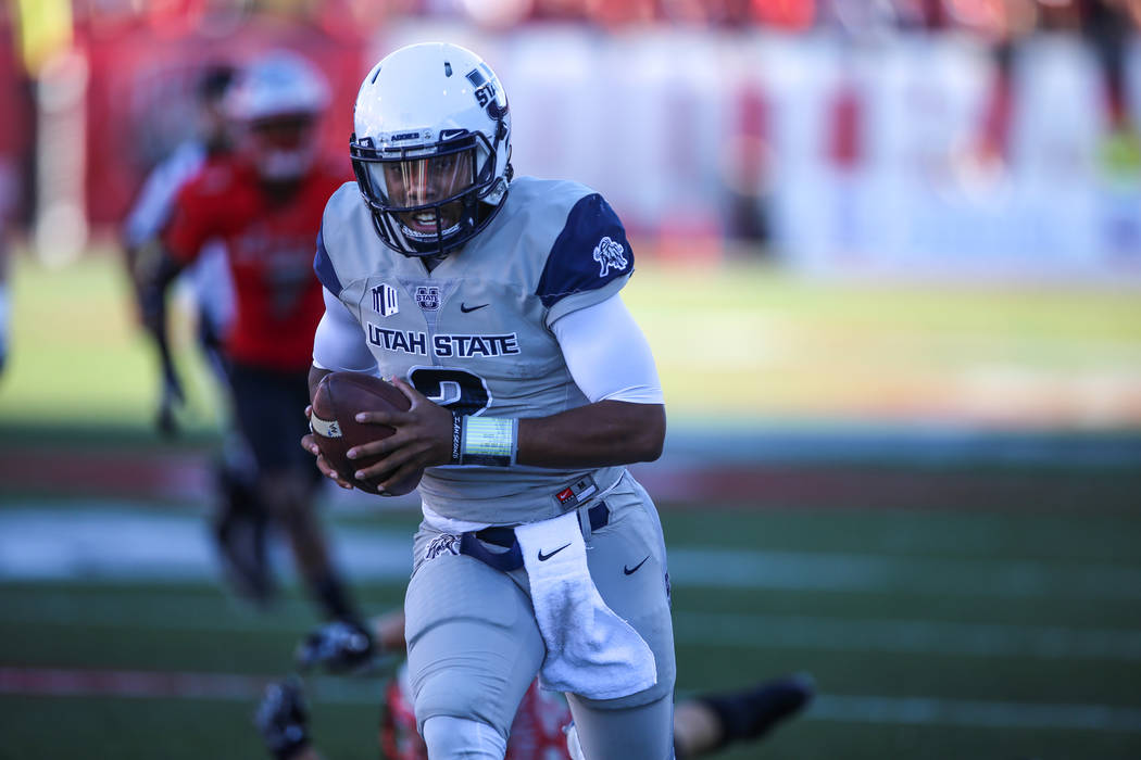 Utah State Aggies quarterback Kent Myers (2) runs the ball against the UNLV Rebels during the second quarter of a football game at Sam Boyd Stadium in Las Vegas, Saturday, Oct. 21, 2017. Joel Ange ...