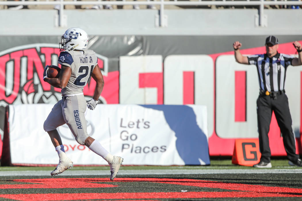 Utah State Aggies quarterback Kent Myers (2) runs the ball against the UNLV Rebels as an offensive flag was thrown during the second quarter of a football game at Sam Boyd Stadium in Las Vegas, Sa ...