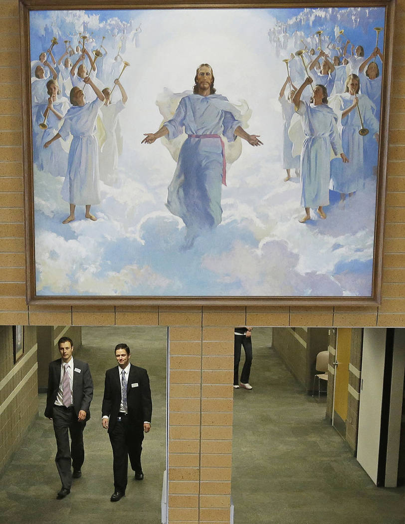 People walk through the halls at the Missionary Training Center in Provo, Utah. (AP Photo/Rick Bowmer, File)