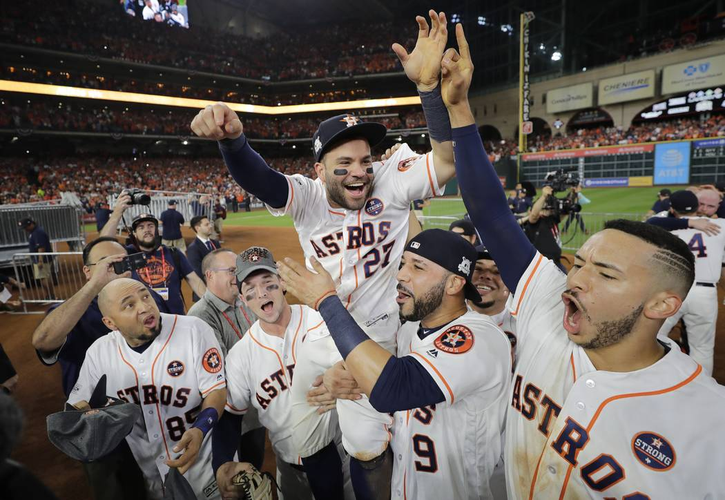 Houston Astros' Jose Altuve is lifted by teammates after Game 7 of baseball's American League Championship Series against the New York Yankees Saturday, Oct. 21, 2017, in Houston. The Astros won 4 ...