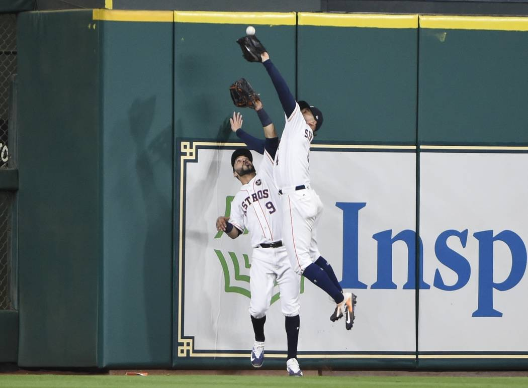 Houston Astros' George Springer catches a fly ball hit by New York Yankees' Greg Bird in front of Marwin Gonzalez during the seventh inning of Game 7 of baseball's American League Championship Ser ...