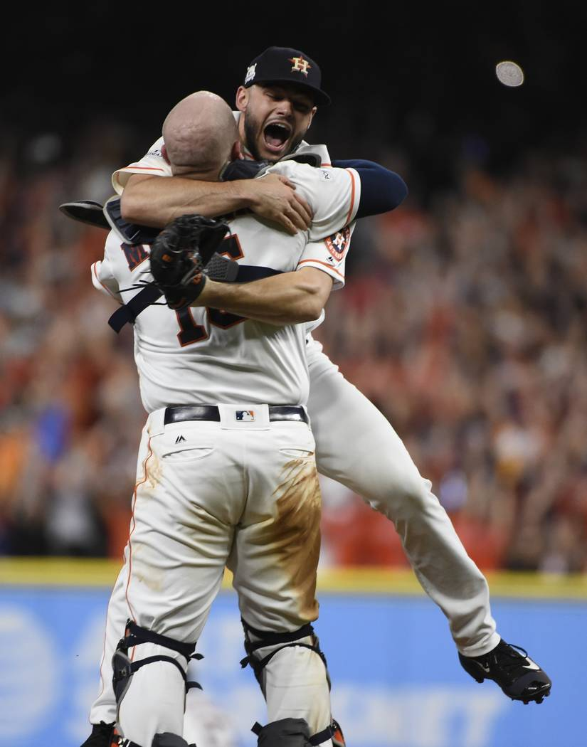 Houston Astros' Lance McCullers Jr. leaps in the arms on Brian McCann after Game 7 of baseball's American League Championship Series against the New York Yankees Saturday, Oct. 21, 2017, in Housto ...