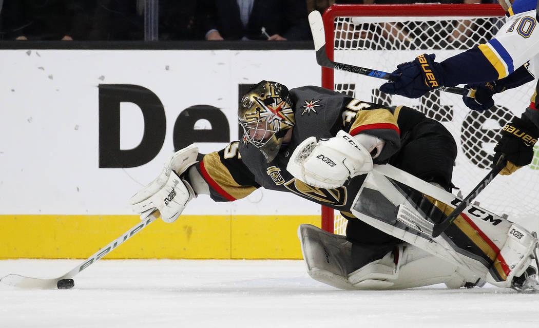 Vegas Golden Knights goalie Oscar Dansk makes a save against the St. Louis Blues during overtime of an NHL hockey game Saturday, Oct. 21, 2017, in Las Vegas. Vegas won 3-2. (AP Photo/John Locher)