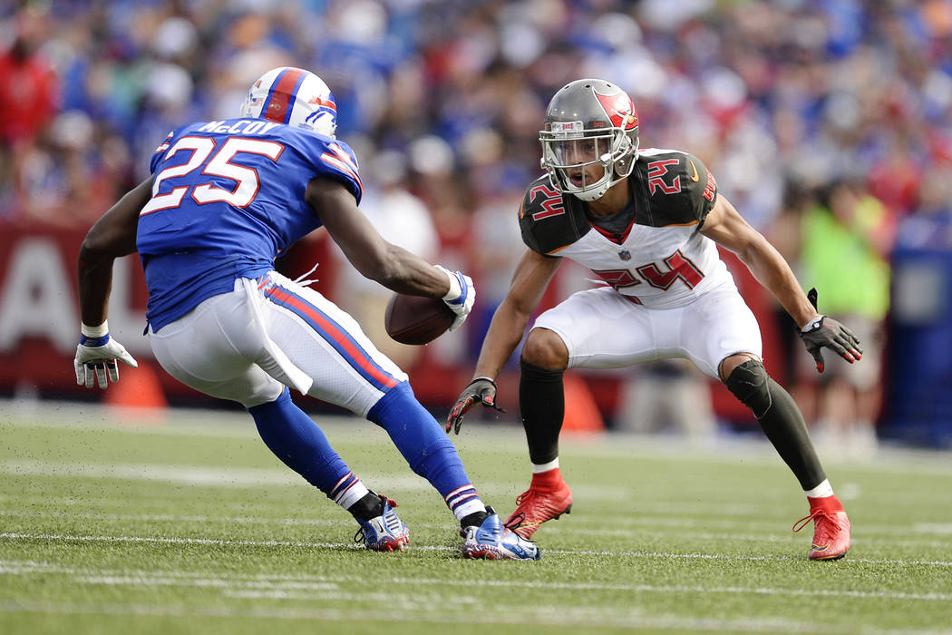 Tampa Bay Buccaneers cornerback Brent Grimes (24) attempts to tackle Buffalo Bills' LeSean McCoy (25) during the second half of an NFL football game Sunday, Oct. 22, 2017, in Orchard Park, N.Y. (A ...