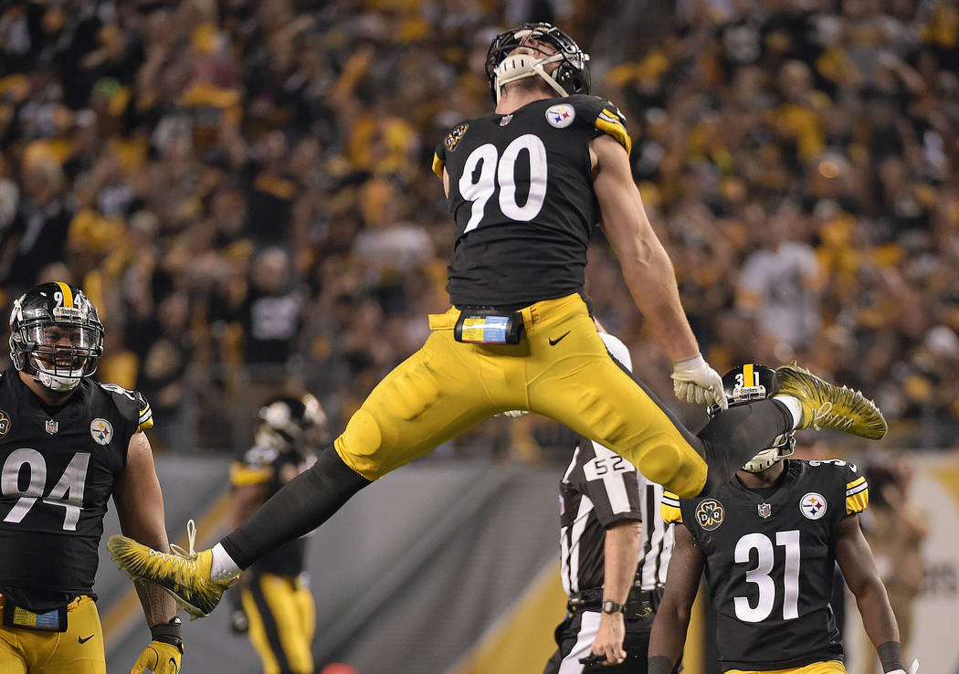 Pittsburgh Steelers outside linebacker T.J. Watt (90) celebrates his sack of Cincinnati Bengals quarterback Andy Dalton (14) during the second half of an NFL football game in Pittsburgh, Sunday, O ...