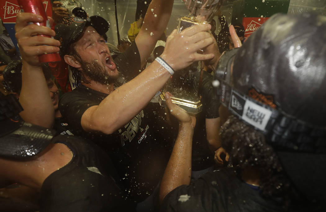 Los Angeles Dodgers' Clayton Kershaw, left, and his teammates celebrate after Game 5 of baseball's National League Championship Series against the Chicago Cubs, Thursday, Oct. 19, 2017, in Chicago ...