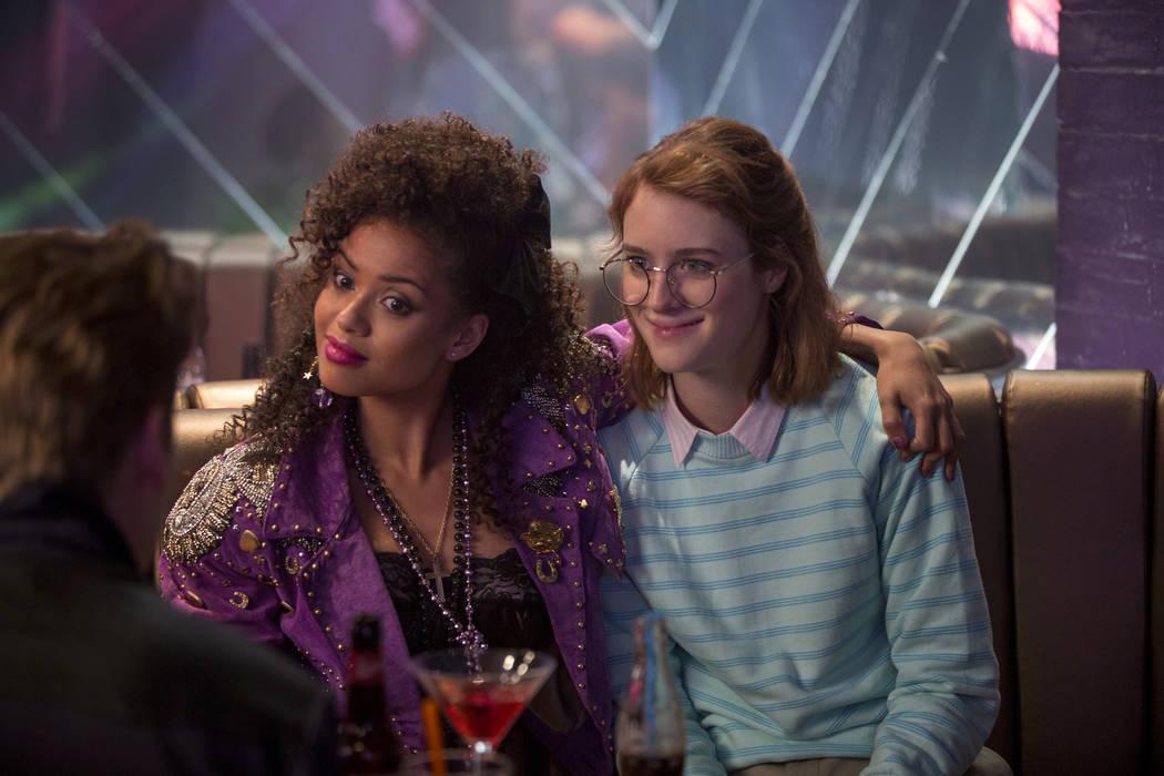 """Gugu Mbatha-Raw, left, and Mackenzie Davis star in the """"San Junipero"""" episode of """"Black Mirror."""" (Laurie Sparham/Netflix)"""