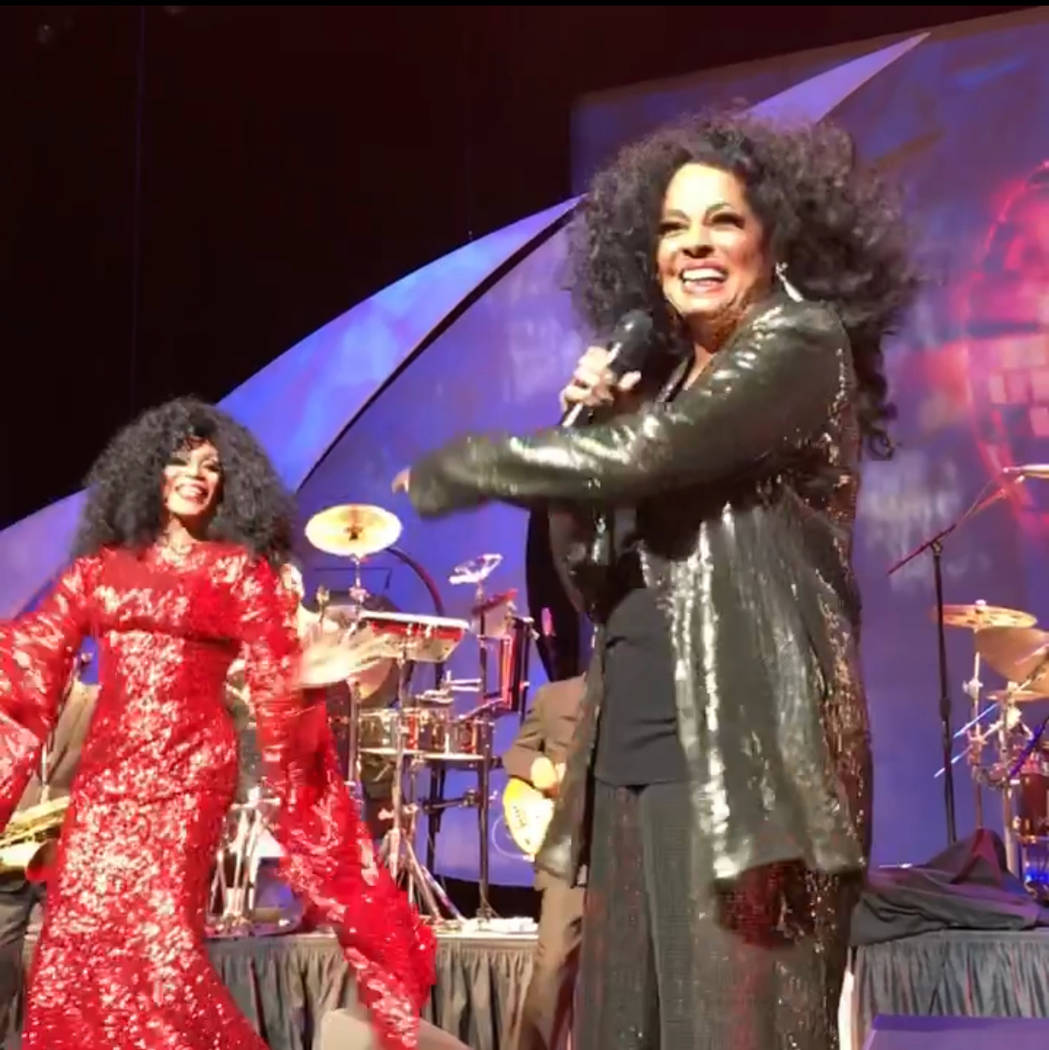 Chris Woods, left, hits the stage with Diana Ross at Encore Theater on Saturday, Oct. 21, 2017. (Frank Marino)