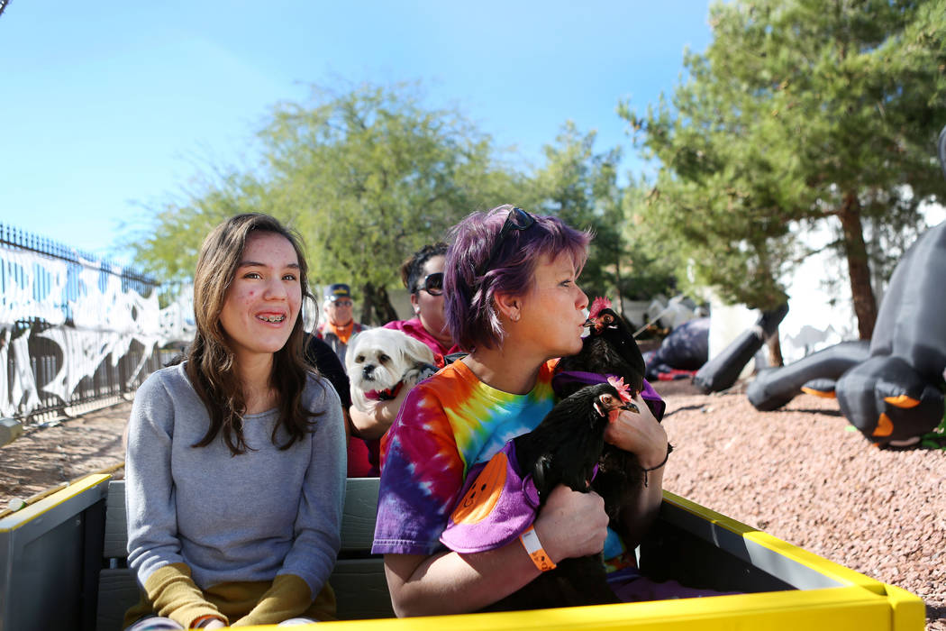 Rebecca Williams, 16, left, and Wendy Cooke ride a train with pets during Opportunity Village's Pumpkin Paws at HallOVeen at the Magical Forest in Las Vegas, Sunday, Oct. 22, 2017. Elizabeth Bruml ...