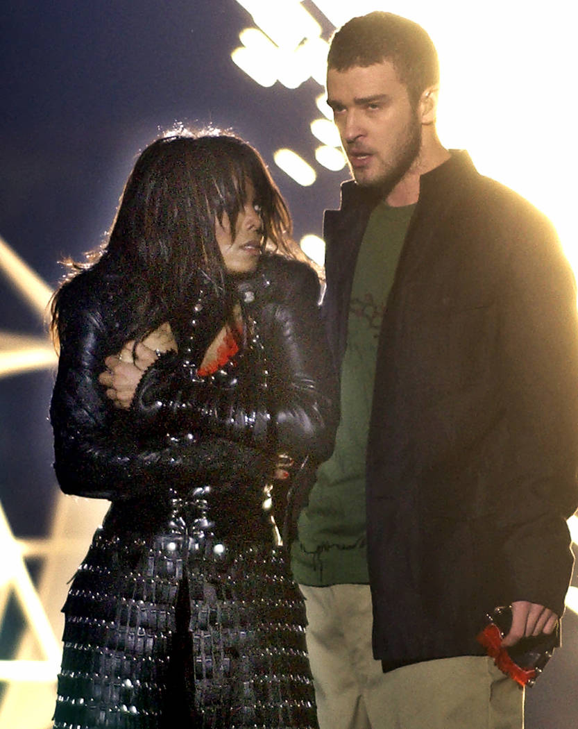 Singer Janet Jackson covers her breast as Justin Timberlake holds part of her costume after her outfit came undone during the halftime show of Super Bowl XXXVIII in Houston in 2004. (AP Photo/Elis ...